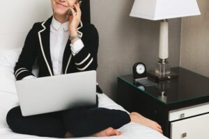 resume writing business woman working on top of a bed